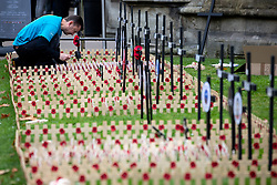 © Licensed to London News Pictures. 05/11/2018. London, UK. Wooden crosses and messages are put into the ground by volunteers as part of the Field of Remembrance at Westminster Abbey, ahead of Armistice day. Traditionally, the poppy is used to commemorate military personnel who have died in World War One. Photo credit : Tom Nicholson/LNP