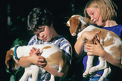 Norah & Friend Holding Brittany Spaniels