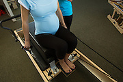 Lotus Pilates Studio owner Liz DeVera works with a client during a prenatal Pilates session at Lotus Pilates Studio in Campbell, California, on October 1, 2013. (Stan Olszewski/SOSKIphoto)
