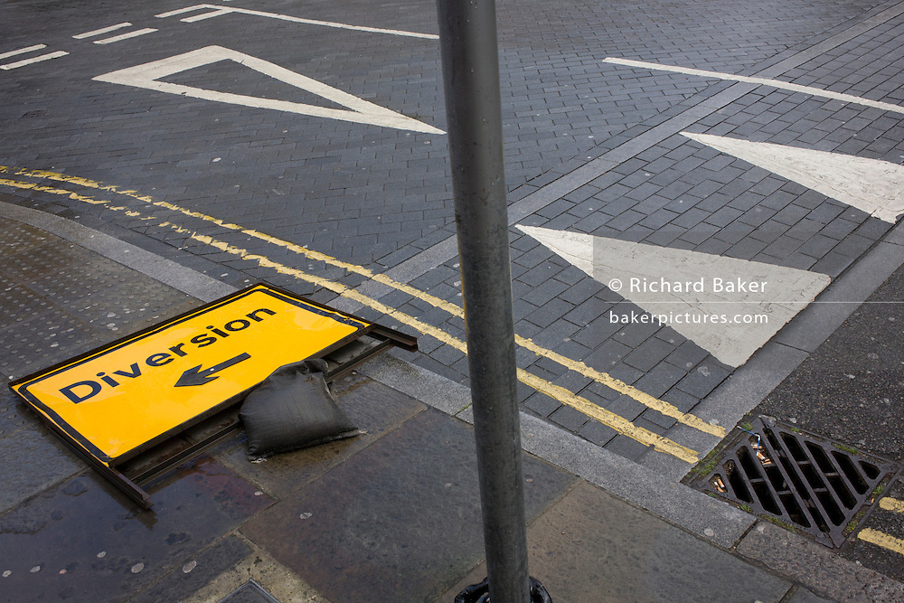 Aerial landscape of road diversion sign and road triangle markings.