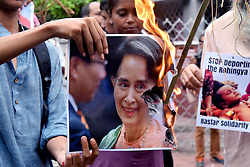 September 4, 2017 - Kolkata, West Bengal, India - A group of activist protest against Rohingya crisis in front of Myanmar Consulate in Kolkata. Myanmar Military and police crackdown on Rohingya Muslims killings thousand at Rakhine state of Myanmar. (Credit Image: © Saikat Paul/Pacific Press via ZUMA Wire)