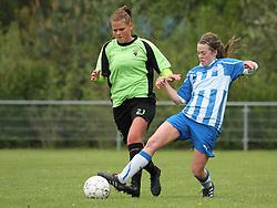 FODBOLD: Josephine Dige (Taastrup FC) tackles af Freja Hansen (OB) under kampen i 3F Ligaen mellem Taastrup FC og OB den 12. maj 2012 i Taastrup Idrætspark. Foto: Claus Birch