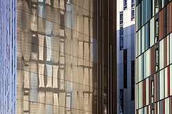 © Licensed to London News Pictures . 27/02/2014 . Manchester , UK . Abstract view of the three towers that make up Manchester's Parkway Gate accommodation scheme on Chester Street , in Manchester City Centre as bright spring sunshine reflects the colours of one tower on to another . Photo credit : Joel Goodman/LNP