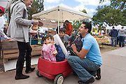 Dozens of local vendor s selling seasonal organic produce. Food vendors, live entertainment, lots of family, children of all ages, green chile roasting, candy apples, breakfast burritos, big pumpkins, arts a& crafts, face-painting...it's all here.
