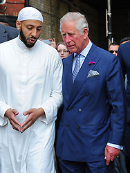 Eds note alternative crop The Prince of Wales (right) speaks to Imam Mohammed Mahmoud as he arrives at Muslim Welfare House in north London to meet members of the local community and hear about the community response following the recent terrorist attack.