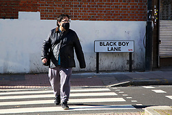 © Licensed to London News Pictures. 22/10/2021. London, UK. A man crosses the road near the Black Boy Lane street sign in north London. Sadiq Khan, Mayor of London has unveiled £25,000 grants to help local communities to change street names as part of a diversity campaign launched following the Black Lives Matter protests. Haringey Council in north London has already moved to change the Black Boy Lane street name. Photo credit: Dinendra Haria/LNP