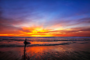 Local Surfer At Low Tide At Sunset