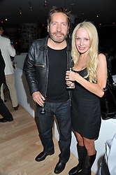 RONAN VIBERT and JESS GRAND at an after party following the first night of Dr Dee: An English Opera,  an opera created by theatre director Rufus Norris and musician and composer Damon Albarn held at St.Martin's Lane Hotel, St.Martin's Lane, London on 25th June 2012.