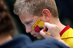 Watford fans have the club badge painted on their faces before the Premier League match at Vicarage Road, Watford