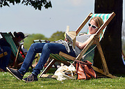 © Licensed to London News Pictures. 06/05/2013. London, UK People relax in Hyde Park. People enjoy the sunny bank holiday Monday weather today 6th May 2013 in London's Royal Parks. Photo credit : Stephen Simpson/LNP