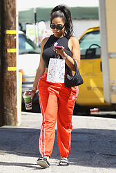 ** PREMIUM EXCLUSIVE RATES APPLY ** Jordyn Woods spotted for the first time following rumours she hooked up with Khloe Kardashian's boyfriend Tristan Thompson. Woods was seen wearing a pair of Balance and Chaos slippers as she stepped out in Studio City, California. On Tuesday evening, Khloe and her best friend Malika Haqq appeared to confirm the cheating scandal surrounding her 27-year-old NBA player boyfriend and Woods, 21, at a house party. Taking to Instagram, the scorned reality star posted a series of cryptic messages while Malika quoted Chris Brown with 'These hoes ain't loyal' in response to the news about Kylie Jenner's best friend Jordyn. Khloe, who has 10-month-old baby daughter True Thompson with Tristan, found out about the hookup and told the Cleveland Cavaliers player they are done for good, according to TMZ. There is no possibility of a reconciliation, the site added. 19 Feb 2019 Pictured: Jordyn Woods spotted for the first time following rumors she had a fling with Tristan Thompson. Photo credit: ROMA / MEGA TheMegaAgency.com +1 888 505 6342