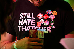 """© Licensed to London News Pictures. 24/09/2016. Liverpool, UK. A momentum supporter wearing a t''shirt reading """"STILL HATE THATCHER"""" before Labour MPs and supporters celebrate  the re-elected of Labour Party Leader Jeremy Corbyn at a party organised by Momentum in Liverpool.  Photo credit: Ben Cawthra/LNP"""