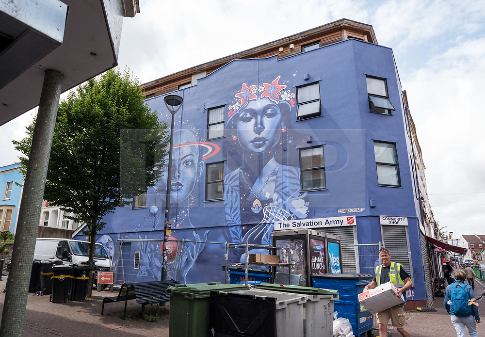 © Licensed to London News Pictures.  30/07/2018; Bristol, UK. Works completed or nearing completion on the third and final day of Upfest, The Urban Paint Festival, 2018 with themes this year including the Simpsons cartoon series and 100 years of the first women getting the vote. Upfest which is Europe's largest Street Art and Graffiti Festival takes place in the Bedminster area of Bristol between Saturday the 28th and Monday 30th of July. In celebration of their 10th anniversary, Upfest will feature the animated family, The Simpsons with 2018 festival goers treated to artist interpretations including Homer, Marge, Bart, Lisa, and Maggie. The festival has also teamed up with Bristol Women's Voice to celebrate the centenary of the first votes for women, and together Upfest and Bristol Women's Voice will celebrate the progress made since 1918, with three artists including Nomad Clan chosen to portray the suffrage movement and the rights of women. Upfest will have 400 artists from 70 countries in attendance, and this year three Upfest artists have been selected by The Simpsons creator Matt Groening to bring The Simpsons to life in their own unique styles: Bao, born and based in Hong Kong, is known for her freestyle work with vibrant murals and illustrations; Soker, a wildstyle writer, is one of Bristol's finest talents and has been putting his mark on the city since the late 80's; Nomad Clan, the collective of Cbloxx and AYLO, one of the most sought-after duos in the international global street art scene. Upfest will be raising money for The National Association for Children of Alcoholics (NACOA) which offers aid and assistance for children growing up in families affected by alcoholism. Photo credit: Simon Chapman/LNP
