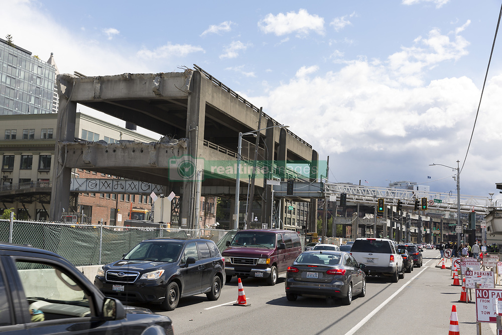 April 27, 2019 - Seattle, Washington, U.S - Seattle, Washington: Crews demolish the Alaskan Way Viaduct near the Seattle Ferry Terminal on the city's central waterfront. A new two mile long bored road tunnel replaced the viaduct, carrying State Route 99 under downtown Seattle from the SODO neighborhood to South Lake Union. The city has now embarked on a multi-year program to rebuild the waterfront including a new surface street, parks and paths. (Credit Image: © Paul Christian Gordon/ZUMA Wire)