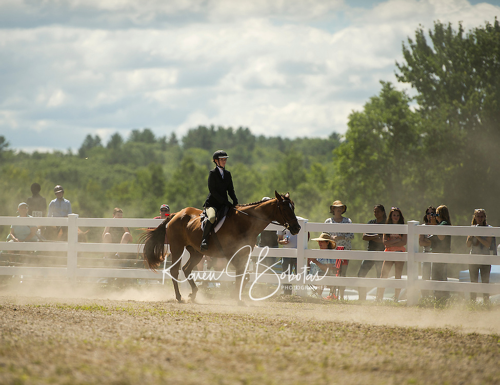 "Emily Maguire of Franklin leads her horse ""Cody"" a Quarterhorse Arabian in the Senior Equitation competition at the Belknap County 4H Fair Saturday morning.  (Karen Bobotas/for the Laconia Daily Sun)"
