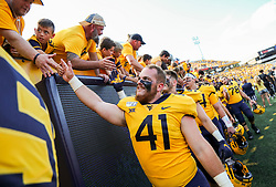 Sep 14, 2019; Morgantown, WV, USA; West Virginia Mountaineers tight end Elijah Drummond (41) celebrates with fans after beating the North Carolina State Wolfpack at Mountaineer Field at Milan Puskar Stadium. Mandatory Credit: Ben Queen-USA TODAY Sports