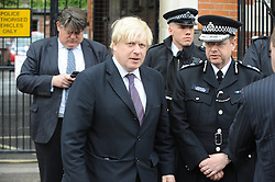 © Licensed to London News Pictures. 23/05/2013.Woolwich Soldier Murder.Boris Johnson   Mayor of London and Ass Comm Simon Byrne arriving at Market Street, Woolwich to walk the murder scene..Woolwich 'terrorist attack': One dead and two seriously injured. Woolwich Barracks,Woolwich..Photo credit :Grant Falvey/LNP