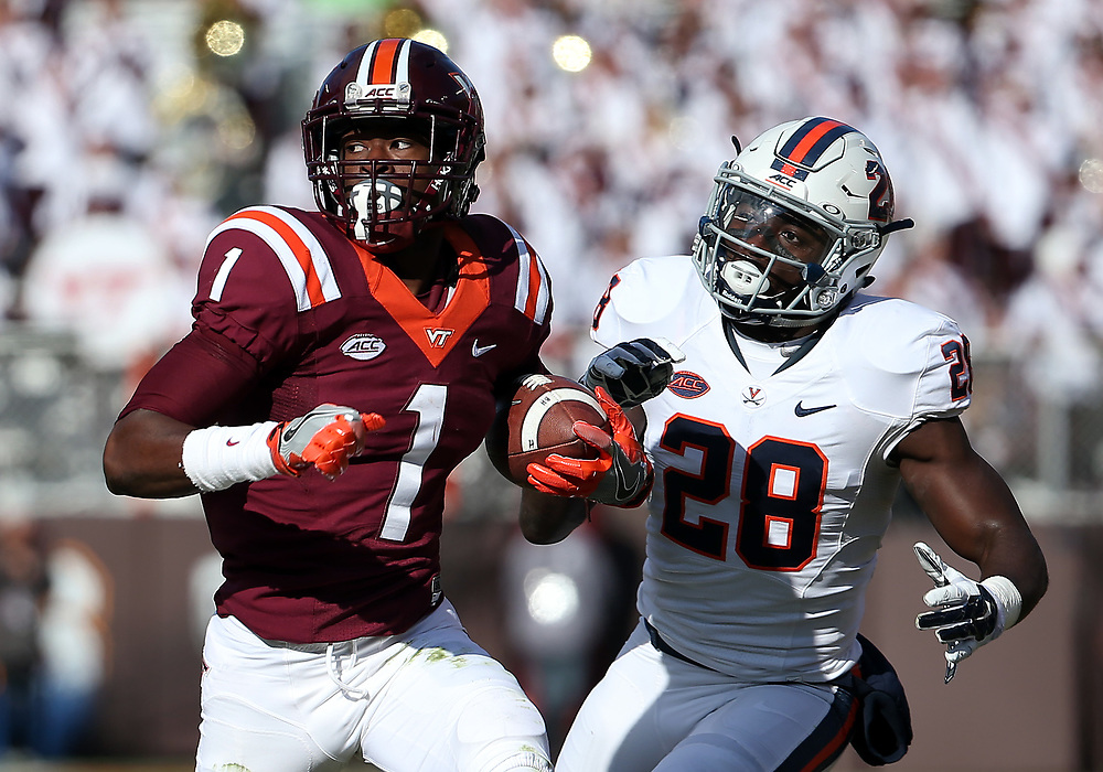 Nov 26, 2016; Blacksburg, VA, USA;  Virginia Tech Hokies wide receiver Isaiah Ford (1) runs the ball against Virginia Cavaliers safety Wilfred Wahee (28) during the second quarter at Lane Stadium. Mandatory Credit: Peter Casey-USA TODAY Sports