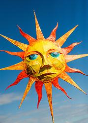 A papier mache representation of the sun in the Penryn Festival in Cornwall