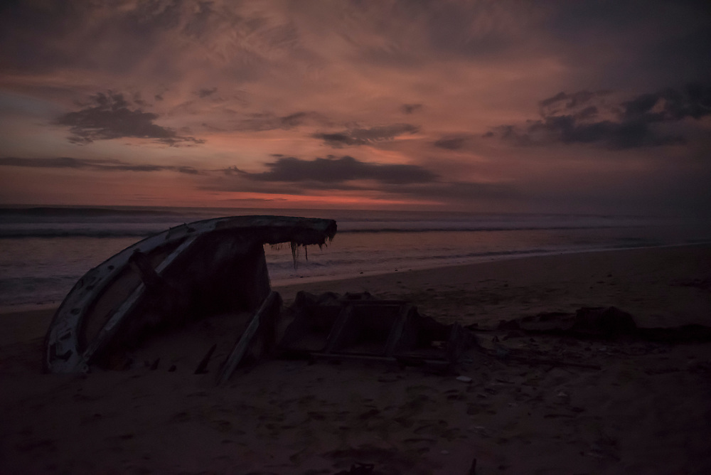 Sunset and shipwreck on Nunggalan Beach in Bali, Indonesia (February 19, 2017)