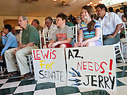 27 JULY 2011 - MESA, AZ: Siblings Logan Perry, 9 and Aubriann Perry, 11, hold signs supporting Jerry Lewis at the Wright House in Mesa Wednesday. Lewis, a Republican, announced that he would run for the Arizona State Senate against incumbent Russell Pearce, who is the subject of a recall. Lewis is an accountant and charter school executive.     PHOTO BY JACK KURTZ