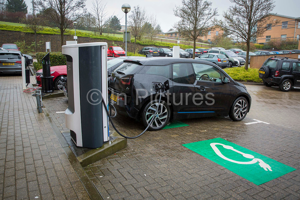 An electric car charging at one of the Chargemaster POLAR Network charging points in the United Kingdom. Chargemaster make and install the charging points in the UK through their POLAR Network, which gives access to over 6,000 charging points.