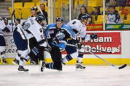 19 February, 2006 - Anchorage, AK:  Aces Patrick Wellar (6) takes a hard hit from IceDog Nick Ganga (39) as Wellar was chasing after the Long Beach controlled puck.  The Alaska Aces take a overtime victory, 3-2 against the visiting Long Beach IceDogs at the Sullivan Arena.