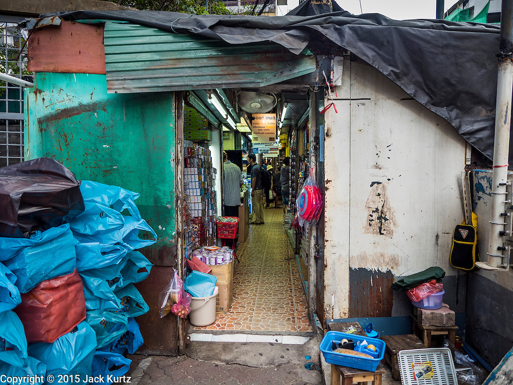 29 SEPTEMBER 2015 - BANGKOK, THAILAND:  The entrance to Saphan Lek market in Bangkok. Street vendors and illegal market vendors in the Saphan Lek area will be removed in the next two weeks as a part of an urban renewal project coordinated by the Bangkok Metropolitan Administration. About 500 vendors along Damrongsathit Bridge, popularly known as Saphan Lek, have 15 days to relocate. Vendors who don't move will be evicted. Saphan Lek is just one of several markets and street vending areas being closed in Bangkok this year. The market is known for toy and replica guns, bootleg and pirated DVDs and CDs and electronic toys.   PHOTO BY JACK KURTZ