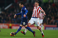 Henrikh Mkhitaryan of Manchester Utd (l) goes past Glenn Whelan of Stoke city. Premier league match, Stoke City v Manchester Utd at the Bet365 Stadium in Stoke on Trent, Staffs on Saturday 21st January 2017.<br /> pic by Andrew Orchard, Andrew Orchard sports photography.