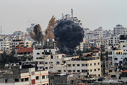 May 5, 2019 - Gaza City, Palestine, 05 May 2019. Israeli aircrafts target a building of the Islamic resistance movement, Hamas, on the west of Gaza City.  The airstrikes are part of an Israeli aerial offensive on the Gaza strip on both Saturday and Sunday that targeted military and civilian buildings and which began after the launch of dozens of rockets from Gaza into Israel on Saturday morning (Credit Image: © Ahmad Hasaballah/IMAGESLIVE via ZUMA Wire)