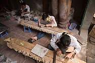Vietnamese people working on some wood decoration. Craft village of Dong Ky, specialized in wood furnitures manufacture. Vietnam, Asia