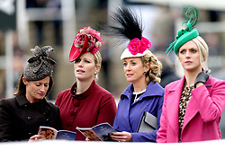 Zara Tindall (second from left) watches the races during Ladies Day of the 2018 Cheltenham Festival at Cheltenham Racecourse.