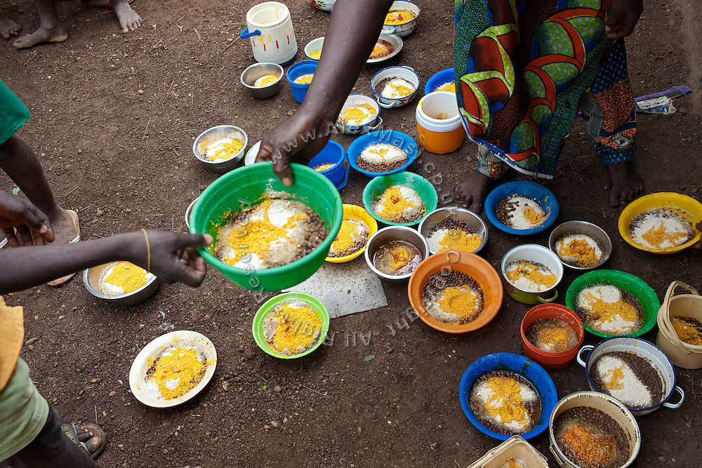 Pupils are helping in distributing the nutritional meals available under the School Feeding Program run by the local NGO SEND at the small rural institution that Hassana Ibrahim, 11, is attending, in Boggu, Tamale, northern Ghana.