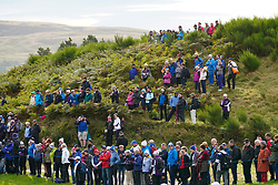Auchterarder, Scotland, UK. 14 September 2019. Saturday morning Foresomes matches  at 2019 Solheim Cup on Centenary Course at Gleneagles. Pictured; Spectators on hillside beside the 8th fairway.  Iain Masterton/Alamy Live News
