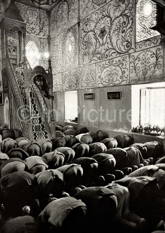 Worshipers in the Et'hem Bey mosque located in the center of the Albanian capital Tirana. In January 1991, despite opposition among communist authorities, ten thousand people entered the mosque. After the 27 year ban on religious worship this event became the onset of the fall of communism in Albania.