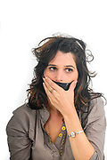 young woman with her mouth taped close