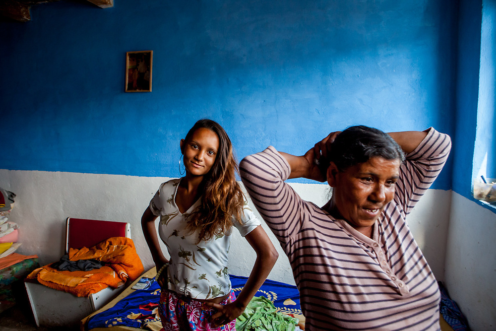 Portrait of 14 years old Darinka with her grandmother Iveta (54) in their home at the Roma settlement in Ostrovany. Darinka wishes to become a teacher in the future.