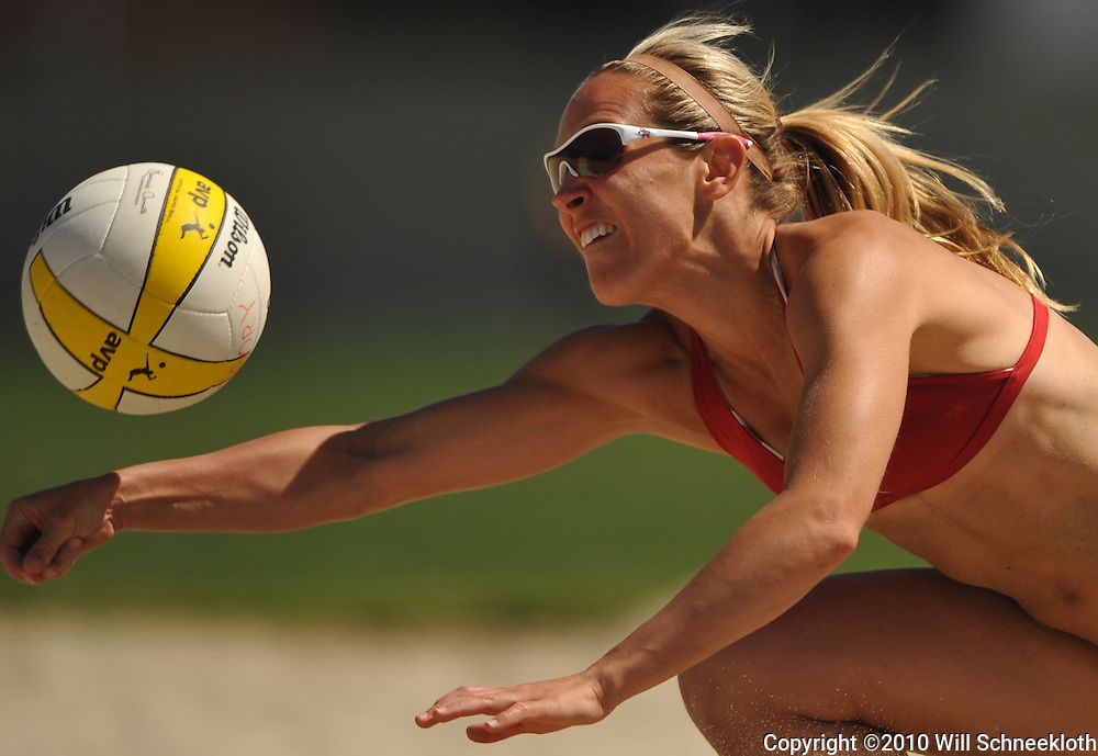 AVP beach volleyball player Jaimi Gregory dives to return the ball during a scrimmage at California State University Long Beach in Long Beach, CA on April 8, 2010.