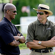 HAVRE DE GRACE, MD, June 5, 2007:  Michelle Wie's agent, Greg Nared, left, and coach David Leadbetter, share a moment while Michelle practices two days before the start of the LPGA Championship in Havre De Grace, MD on June 5, 2007.  (Photo by Todd Bigelow/Aurora)