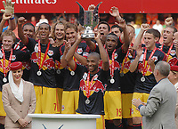 Football - Emirates Cup - Arsenal vs. New York Red Bulls 31/07/2011 Thierry Henry (NY Bulls) lifts the Emirates Cup trophy. Credit : Colorsport / Andrew Cowie