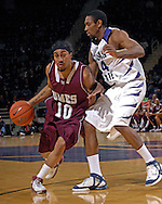 Maryland Eastern Shore guard Jesse Brooks (10) drives against Kansas State guard Akeem Wright (34) in the first half at Bramlage Coliseum in Manhattan, Kansas, December 19, 2006.  K-State lead the Hawks at halftime 46-23.<br />