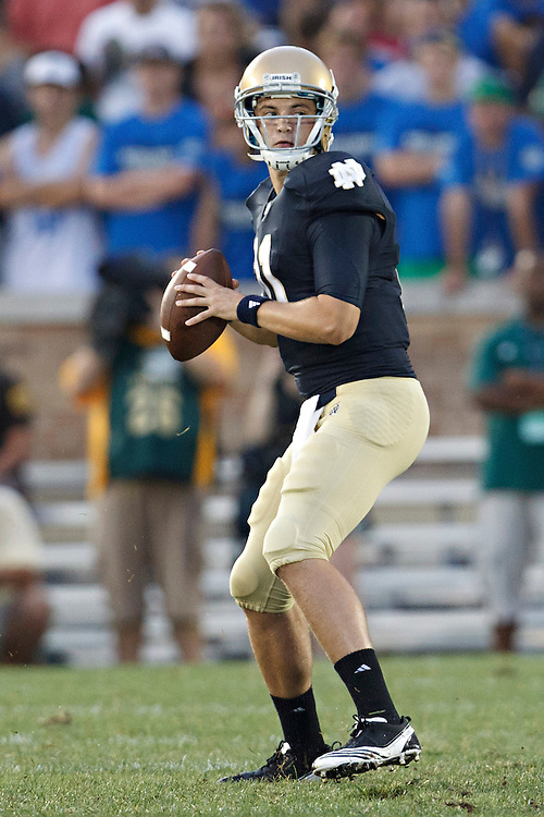 Notre Dame quarterback Tommy Rees (#11) looks to pass the ball in action during NCAA football game between Notre Dame and South Florida.  The South Florida Bulls defeated the Notre Dame Fighting Irish 23-20 in game at Notre Dame Stadium in South Bend, Indiana.