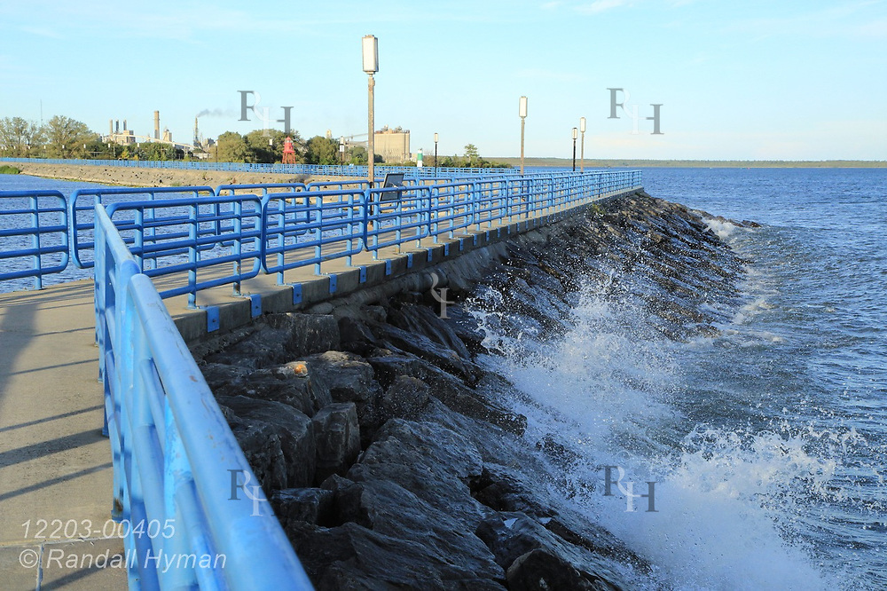 Small waves crash against breakwater on a September afternoon in Alpena, Michigan.