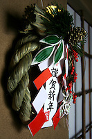 Shimekazari, Japanese New Year Decorations - For hanging on the front door, there is the shimekazari, which varies from region to region but always contains many auspicious ingredients. There is usually a small folding fan on top representing the your generating plenty of descendants, an orange which means generation after generation, and a small lobster  who with their bent backs represent attaining old age. There is also some red and white folded shide paper which is effective for preventive impurities from entering the house.