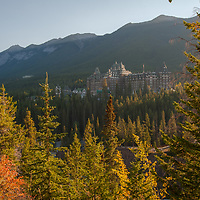 The classic Banff Springs Hotel rises from a forest in Banff National Park, Alberta, Canada.