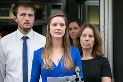 "© Licensed to London News Pictures. 14_07_2015. Solihull, West Midlands, UK. Pictured, BRYHER DUNSBY, widower of James Dunsby reads a statement outside the inquest wearing her husbands wedding ring around her neck on a chain. The inquest into the deaths of three army reservists taking place at Solihull Council House. Edward Maher, Craig Roberts and James Dunsby died after collapsing during an SAS training exercise on the Brecon Beacons in July 2013. The soldiers, from Hampshire, North Wales and Wiltshire, all suffered heatstroke during the 16-mile ""test week"" march. Photo credit : Dave Warren/LNP"