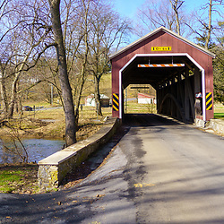 Brownstown, PA / USA – February 3, 2020: Zook's Mill Bridge is a red 74 feet covered bridge that spans the Cocalico Creek in Lancaster County. It was featured in the 1978 film The Boys from Brazil.