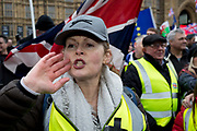 On the day that Prime Minister Theresa Mays Meaningful Brexit vote is taken in the UK Parliament, a far-right yellow jacket heckles protesting Remainers opposite the House of Commons, on 15th January 2019, in Westminster, London, England.