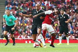 July 30, 2017 - London, England, United Kingdom - Arsenal's Alexandre Lacazette holds of Steven N'Zonzi of Sevilla FC..during Emirates Cup match between Arsenal  against Savilla FC   at The Emirates Stadium in north London on July 30, 2017, the game is one of four matches played over two days for the Emirates Cup. (Credit Image: © Kieran Galvin/NurPhoto via ZUMA Press)