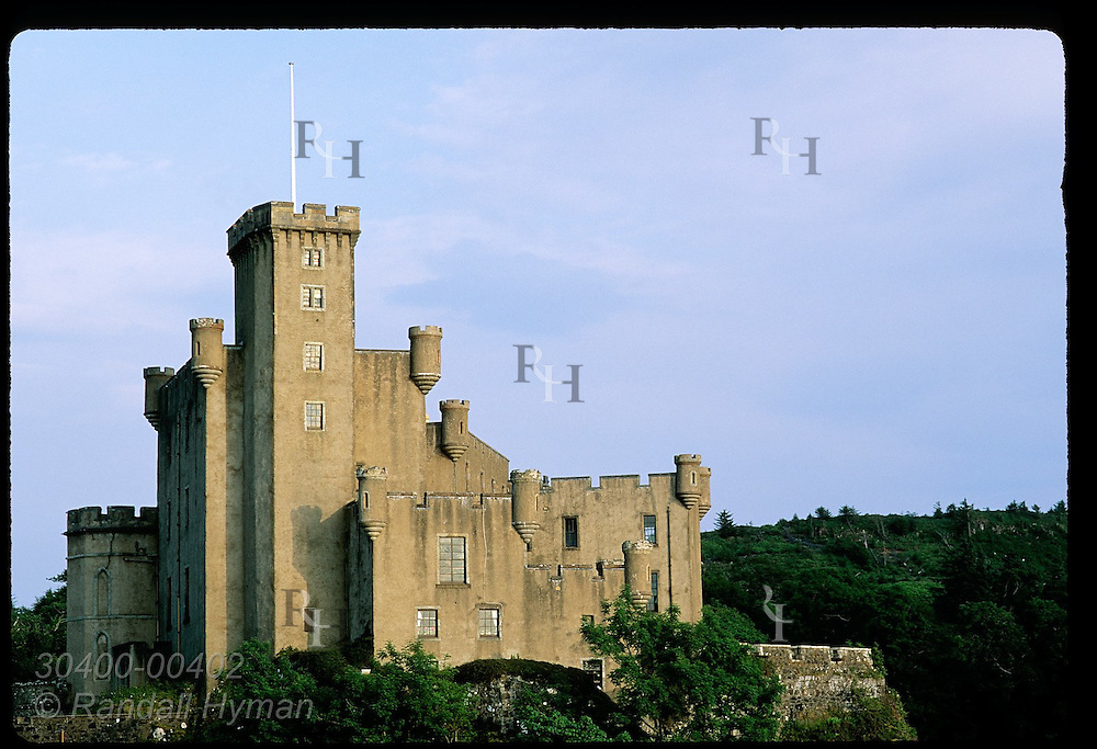 Dunvegan Castle, home of MacLeod clan chiefs since 1200s, at dusk on the Isle of Skye. Scotland
